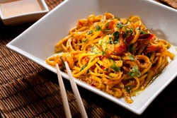 Chinese noodles with shrimps on a bamboo table