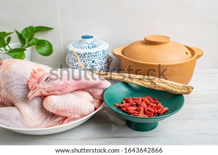 Chinese nutritious health soup ingredients, fresh hen and Codonopsis medlar