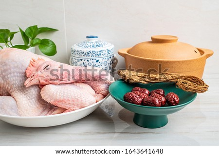 Chinese nutritious health soup ingredients, fresh hen and red date angelica