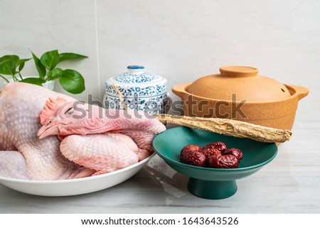 Chinese nutritious health soup ingredients, fresh hen and red date codonopsis