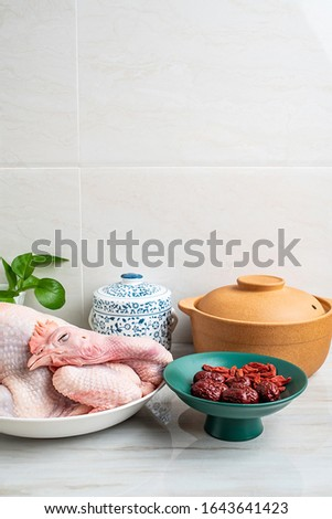Chinese nutritious health soup ingredients, fresh hen and red dates and wolfberry