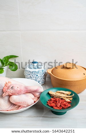 Chinese nutritious health soup ingredients, fresh hen and wolfberry angelica flakes