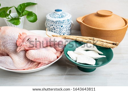 Chinese nutritious health soup ingredients, fresh hen and yam codonopsis