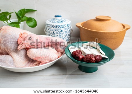Chinese nutritious health soup ingredients, fresh hen and yam red dates