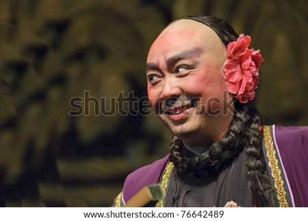Chinese opera actor performs on stage