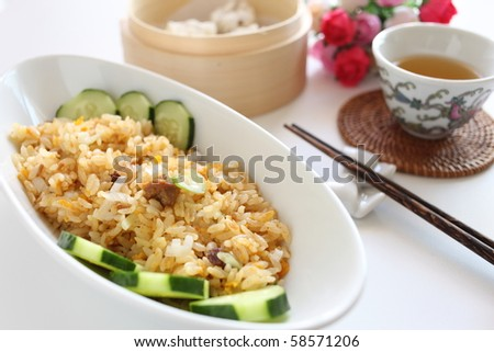 Chinese Pork Fried Rice on the table with Chinese tea and dumpling - stock photo