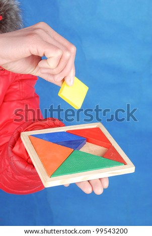 Chinese puzzle in hand - stock photo
