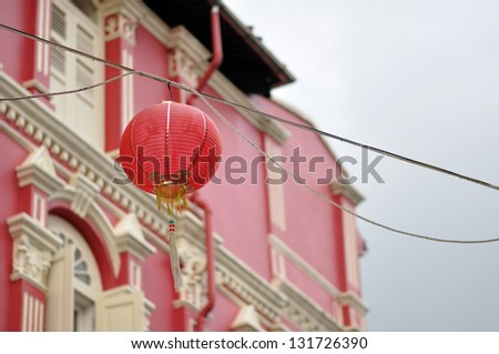 Chinese red lanterns in street, Chinatown, Singapore with  traditional Facade of the red building