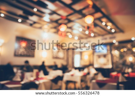 Chinese restaurant decorated for new year celebration in bokeh with retro film filter effect, defocused background