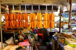 Chinese sausage hung on a rail, Chinese sausage waiting for distribution, Chinese sausage shop