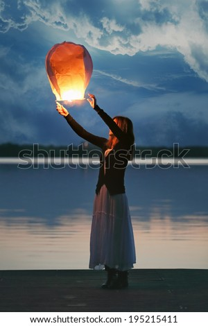 Chinese Sky Lantern Flying Away , Carrying Young Woman ...
