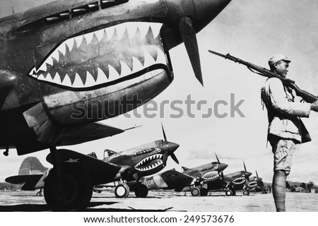 Chinese soldier guards a line of American P-40 fighter planes ca 1942 The shark-face fighters of the Flying Tigers had a 12-to-1 victory ratio over the Japanese planes during World War 2