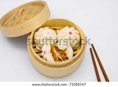 Chinese steamed dumpling  in bamboo containers traditional cuisine