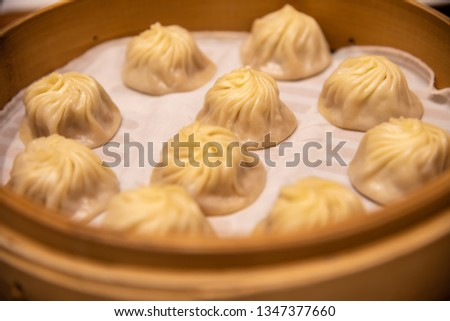 Chinese steamed steamed bun ( baozi ) named Xiaolongbao also called a soup dumpling. It is traditionally prepared in xiolong small bamboo steaming basket. #1347377660