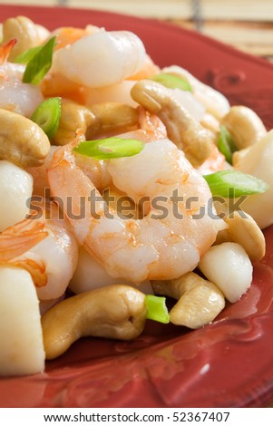Chinese stir-fried shrimp with cashews, water chestnuts, and green onion.
