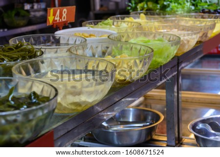 Chinese street food. Street trading. Chinese kinds of fresh seafood at an asian seafood market in Sanya, Hainan province