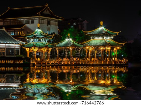 Chinese style pavilion in the night with reflection of light #716442766