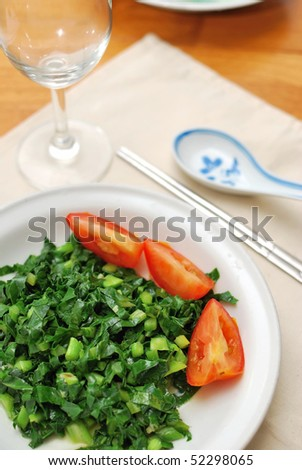 Chinese style stir fried vegetables and raw tomatoes. Suitable for food and beverage, healthy eating and diet and nutrition concepts.