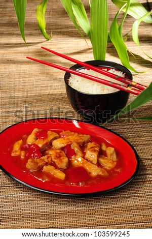 Chinese sweet and sour chicken served with basmati rice