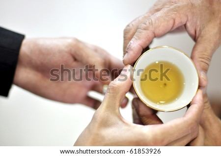 Chinese Tea ceremony is performed during a Chinese wedding or Chinese New Year. - stock photo