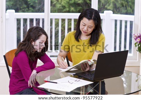 Chinese teacher going over test results with her student