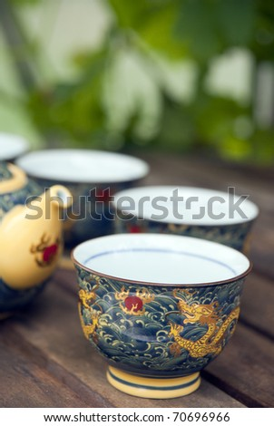 Chinese teacup on table in summer