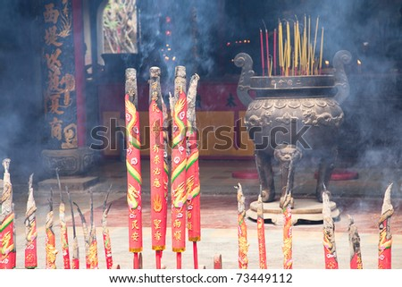 Chinese Temple filled with smoke from burning incenses. New Year's Eve. Ho Chi Minh, Vietnam