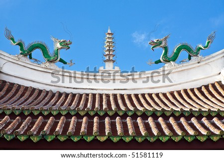 Chinese Temple Roof -- Ridge of Chinese temple decorated with a mythological dragons