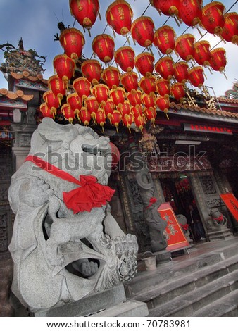 Chinese Tradition stone lion with red New Year lantern