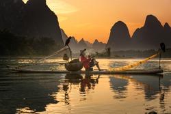 Chinese traditional fisherman with cormorants fishing, Li River
