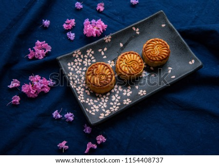 Chinese traditional food moon cakes and pink flowers #1154408737