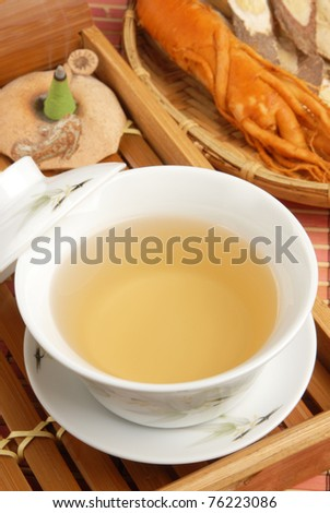 Chinese traditional ginseng tea and herbs - stock photo