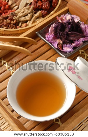 Chinese traditional herbal tea and herbs - stock photo