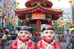 Chinese traditional statues outside one of the streets of Yokohama Chinatown, one of the busiest touristic areas of Japan. The Chinese characters mean