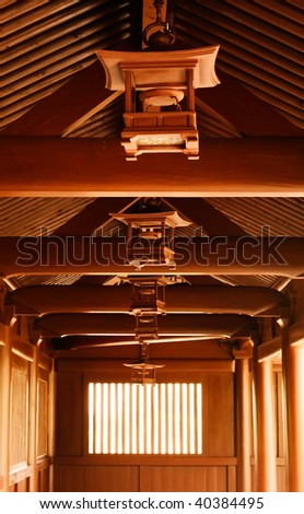 Chinese traditional wooden brown lamp at the celling of temp in corridor