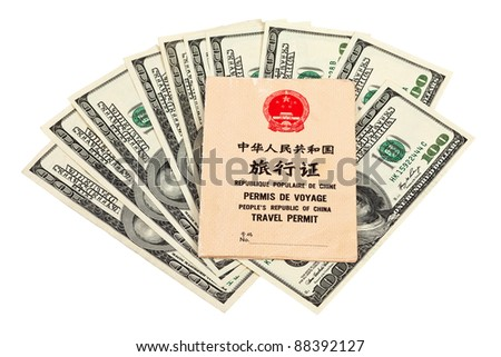 Chinese Travel permit and US dollars over white