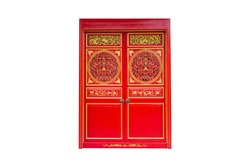 Chinese twin wooden doors in red and golden color isolated on white background with clipping path. Asia entrance architecture.