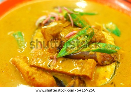 Chinese vegetarian curry cooked with mock fish meat, lady fingers and tomatoes. Suitable for food and beverage, healthy lifestyle, and diet and nutrition.