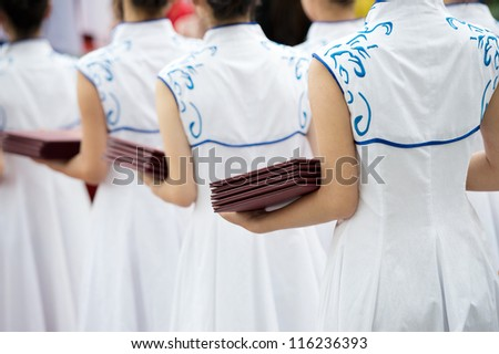 Chinese waitress dressed neatly in a row.