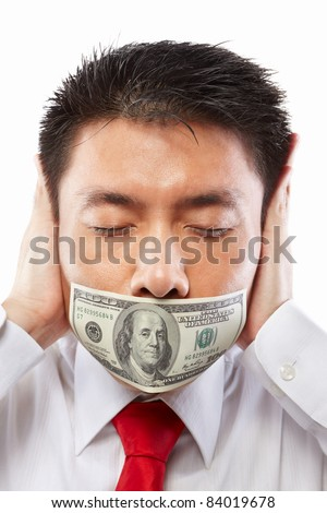 Chinese young man with his mouth sealed by a hundred dollar bills for bribe concept