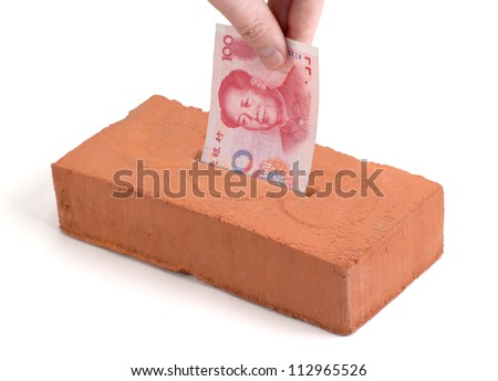 "Chinese Yuan bank note in a ""piggy bank"" or ""tissue box"" like brick"