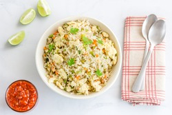 ChineseEgg Fried Rice with Vegetables and Chili Sauce Top View Photo. Oriental Cusine, Chinese Food, Comfort Food, Popular American Food.