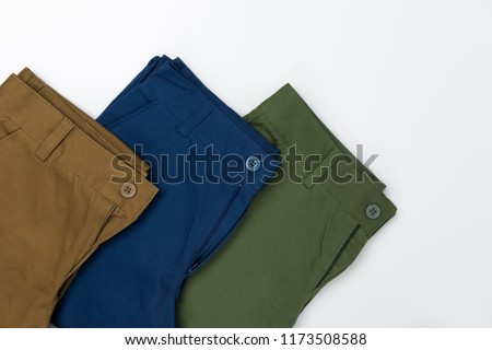 Chino Pants for men  isolated on white background, Brown , Green and Light navy color. Foto stock ©