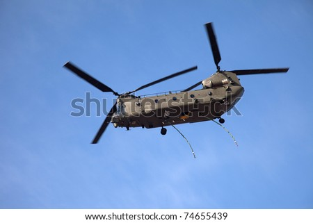 Chinook helicopter flying over a beach on the Isle of  Anglesey North wales
