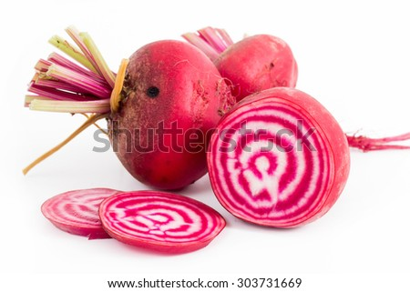 Chioggia striped or candy stripe beet  whole and sliced isolated on white background
