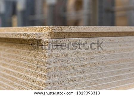 Chipboard sheets in the store, texture. Lumber is sold at the supermarket or warehouse. Close-up with copy space. Foto d'archivio ©