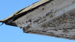 Chipping paint on rooftop edge.