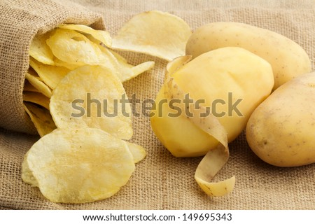 chips and peeled potato on a jute texture