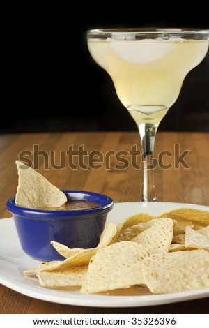 Chips and salsa, with a tasty margarita