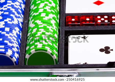 Chips, cards and dice in a suitcase. Set a game of cards